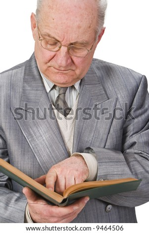 Close-up image of a senior man reading a book attentively. - stock photo