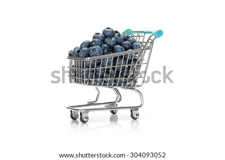Close up image of a shopping cart filled with blueberries with a small reflection on pure white background. Healthy shopping and eating concept. - stock photo