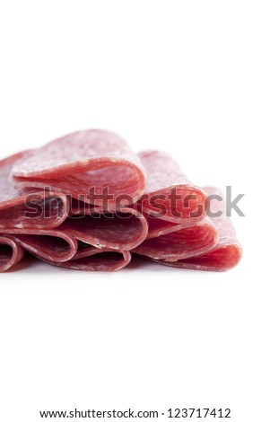 Close-up image of a sliced ham lying on the white background
