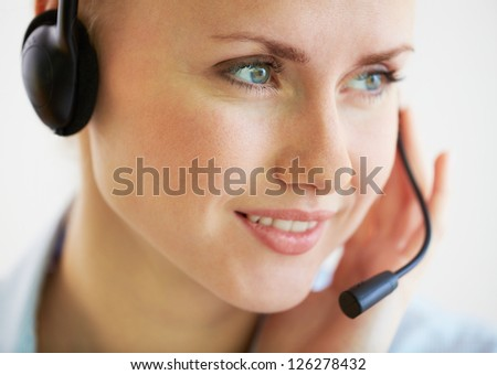 Close-up image of a smiling helpdesk operator consulting the client - stock photo