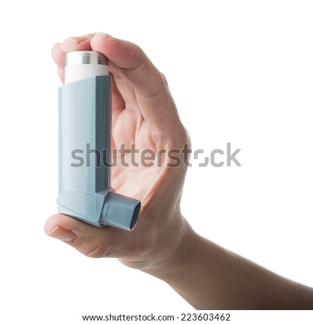 Close up image of a woman hand holding asthma inhaler isolated on white background  - stock photo