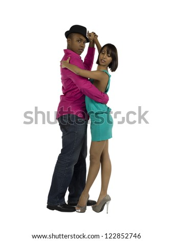 Close-up image of a young couple dancing rumba against the white surface
