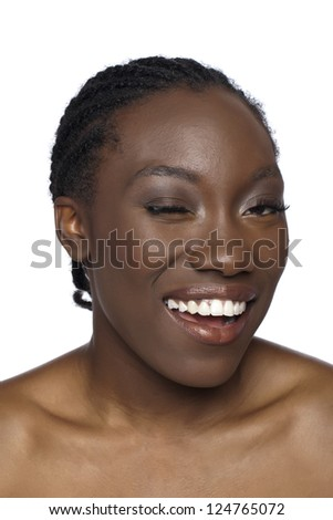 Close-up image of an African woman winking over the white background - stock photo