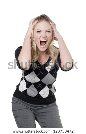 Close up image of an angry woman holding her head against the white background - stock photo