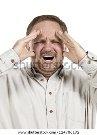 Close-up image of an old man suffering from a head ache against the white background