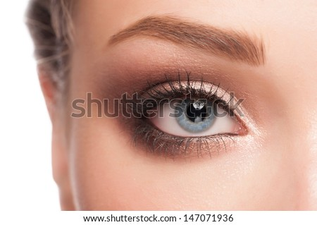 Close-up image of beautiful woman blue eye with bright makeup  - stock photo