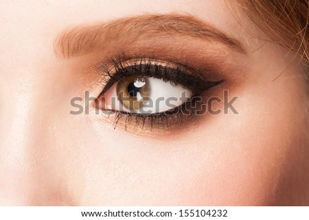 Close-up image of beautiful woman eye with bright makeup  - stock photo