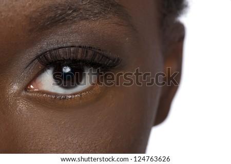 Close up image of black woman eye against white background - stock photo