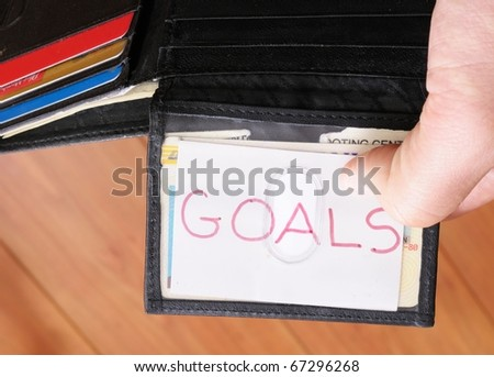 Close up image of business card with goals written on it - stock photo