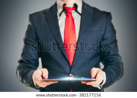 Close up image of business man holding a digital tablet  - stock photo