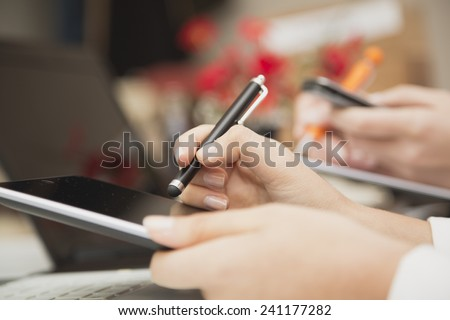 Close-up image of business people working in office environment  - stock photo