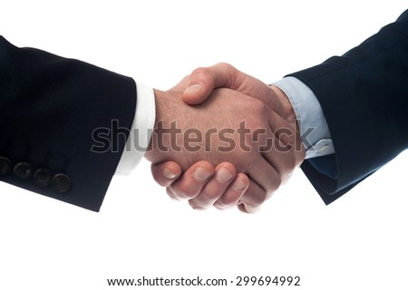 Close up image of businessmen handshake  - stock photo