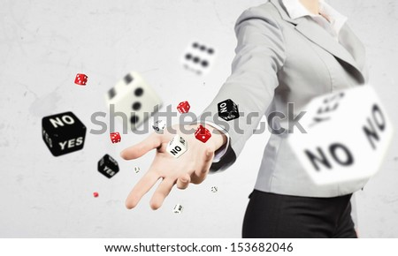 Close-up image of businesswoman throwing dices. Gambling concept - stock photo