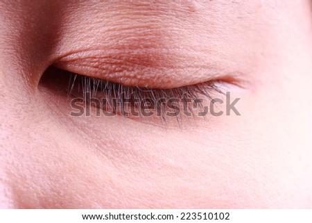 close up image of closed eyes - stock photo