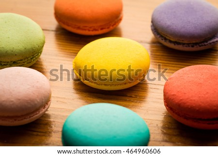 Close-up image of colorful macaroons on wood