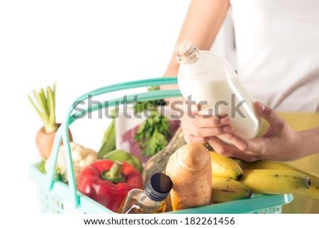 Close-up image of customer basket isolated on white  - stock photo