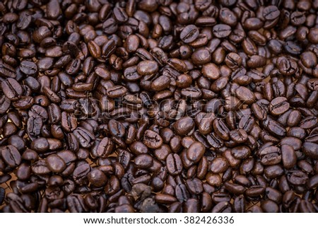 Close up image of dark roasted coffee beans creating an inviting background - stock photo