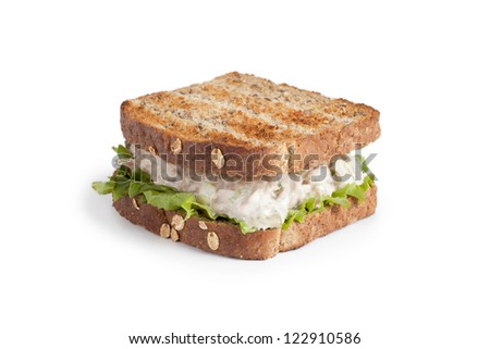 Close up image of delicious egg salad sandwich against white background - stock photo