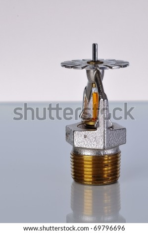 Close up image of fire sprinkler. Fire sprinklers are part of an integrated water piping system designed for life and fire safety. - stock photo