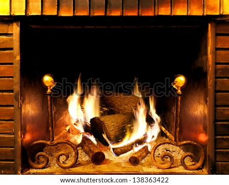 close up image of fireplace and wood burning - stock photo
