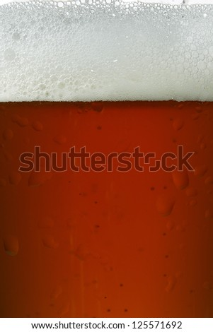Close up image of glass of beer - stock photo