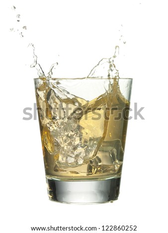 Close up image of glass of cocktail drink against white background - stock photo