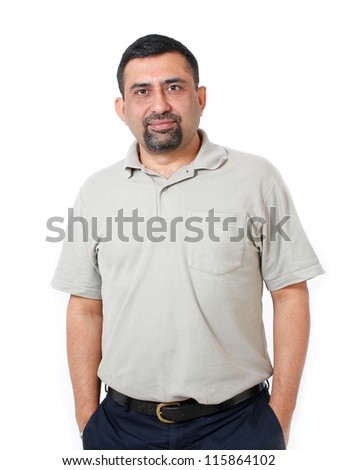 Close-up image of healthy, cool & happy asian/indian executive with a smile. The person is wearing a casual T-shirt & the picture is shot in a studio and isolated on white - stock photo