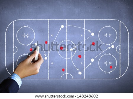 Close up image of human hand drawing hockey tactic plan - stock photo