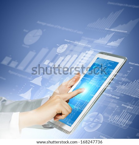 Close up image of human hand touching screen of tablet pc - stock photo