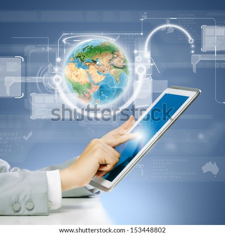Close up image of human hand touching screen of tablet pc. Elements of this image are furnished