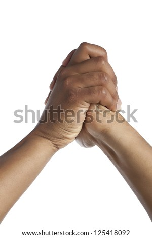 Close-up image of human hand with a praying gesture isolated on a white surface