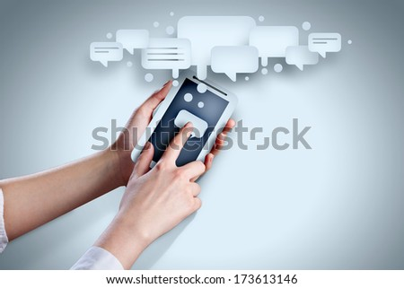 Close-up image of human hands holding smartphone