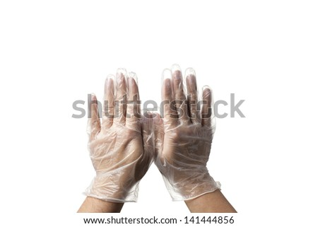 Close-up image of human hands with transparent surgical gloves. - stock photo