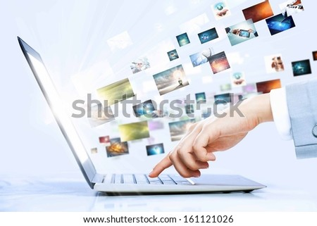 Close up image of laptop and human hands typing on keyboard - stock photo