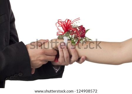Close-up image of male hand holding female hand with corsage isolated on a white background - stock photo