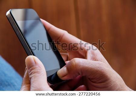 close up Image of man checking his phone - stock photo