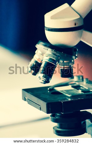 close up image of  microscope on the table ,image in soft focus