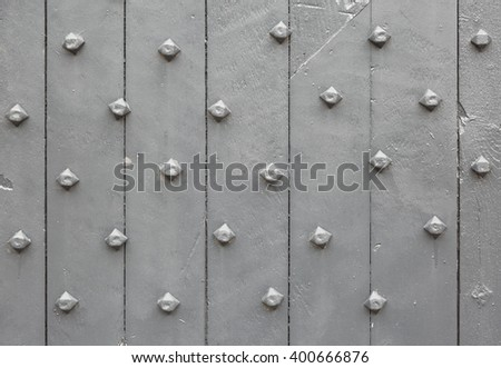 Close up image of old grey painted wooden door - stock photo