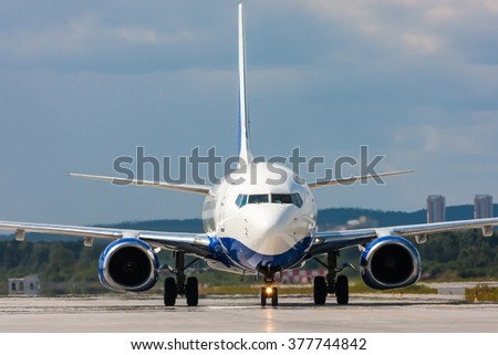 Close up image of passenger airplane on the runway - stock photo
