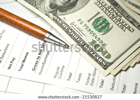 Close up image of pen, checkbook and US dollars - stock photo