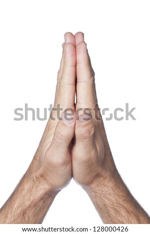 Close up image of praying hands of a man against white background - stock photo