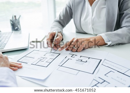 Close-up image of realtor consulting client in her office