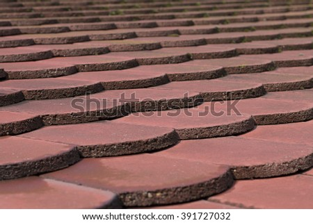 Close-up image of red brick roof tiles - stock photo