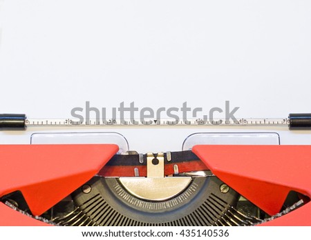 close up image of red typewriter with paper sheet. copy space for your text.  - stock photo