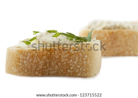 Close up image of slice of bread with butter against white background