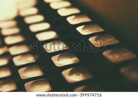 close up image of typewriter keys. vintage filtered. selective focus  - stock photo