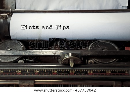 close up image of typewriter with paper sheet and the phrase: hints and tips. copy space for your text. retro filtered  - stock photo