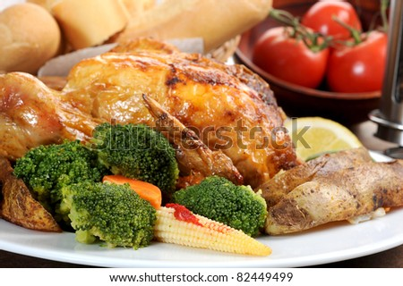 Close-up image of veggies with roasted chicken