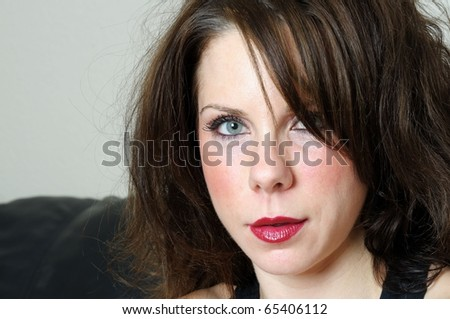 Close-up image of young beautiful female caucasian - stock photo