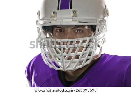 Close up in the eyes of a Football Player with a purple uniform on a white background.